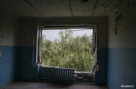 A room in a hospital, which was damaged during fighting between the Ukrainian army and pro-Russian separatists, is seen in Avdiyivka near Donetsk Sept. 8, 2014.