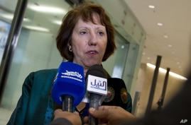 European Union High Representative Catherine Ashton speaks with the media as she arrives for a meeting of EU Foreign Ministers in Luxembourg on Monday Oct. 15