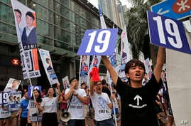 Supporters of Radical localist group Youngspiration's candidate Baggio Leung shout slogans near a polling station for the legislative council election, Sept. 4, 2016.