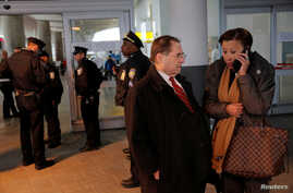 Congressman Jerrold Nadler, left, and Congresswoman Nydia Velazquez, right, stand in the entrance of Terminal 4 at John F. Kennedy International Airport in Queens, New York, Jan. 28, 2017.