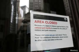 A sign informs visitors that Federal Hall is closed because of the government shutdown in New York City, Jan. 3, 2019.