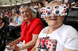 Spectators are pictured during the opening ceremony of the London 2012 Olympic Games at the Olympic Stadium July 27, 2012.