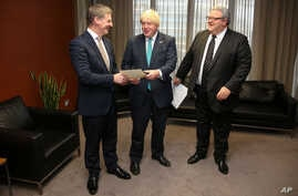 British Foreign Secretary Boris Johnson, center, meets with New Zealand Prime Minister Bill English and Foreign Minister Gerry Brownlee, right, in Wellington, New Zealand, July 25, 2017.
