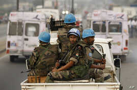 United Nations soldiers from Niger conduct a patrol through the streets of Abidjan, Ivory Coast (2011 file photo).