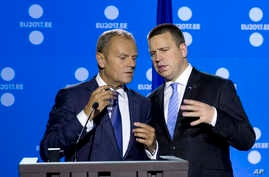 Estonian Prime Minister Juri Ratas (R) speaks with European Council President Donald Tusk, prior to addressing the media at the conclusion of an EU Digital Summit in Tallinn, Estonia, on Sept. 29, 2017.