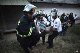 Firefighters carry a woman who fainted outside a reformatory for youth and men, Centro Correccional Etapa II, where a riot and fire broke out in San Jose Pinula, Guatemala, March 19, 2017.