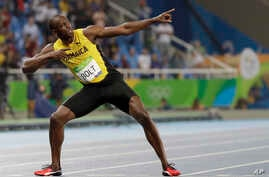 Usain Bolt from Jamaica celebrates winning the gold medal in the men's 200-meter final during the athletics competitions of the 2016 Summer Olympics at the Olympic stadium in Rio de Janeiro, Brazil, Thursday, Aug. 18, 2016.