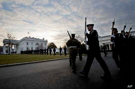 Honor guards from different branches of the U.S. Armed Forces, march on the North Lawn driveway of the White House in Washington, Jan. 15, 2017.