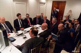 U.S. President Donald Trump is shown in an official White House handout image meeting with his National  Security team after a missile strike on Syria in West Palm Beach, Florida, April 6, 2017.