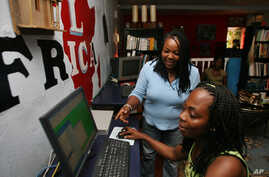 Ciata Victor, who is a Liberian returnee, instructs an unidentified lady inside her  Internet cafe in Monrovia, (File photo).
