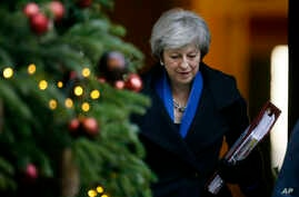 Britain's Prime Minister Theresa May leaves 10 Downing Street for Prime Minister's Questions at the House of Commons, in London, Dec. 19, 2018.