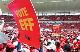 Supporters of South Africa's radical left-wing party, the Economic Freedom Fighters, hold a placard during the launch of the party's election manifesto in Soshanguve, near Pretoria, South Africa, Feb. 2, 2019.