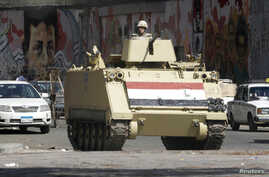 A soldier stands guard in a tank in Tahrir square in Cairo, Egypt, Aug. 14, 2014.