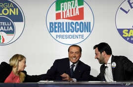 FILE - From left, Brothers of Italy's Giorgia Meloni, Forza Italia's Silvio Berlusconi, and the League's Matteo Salvini attend a media event for center-right leaders ahead of the March 4 general elections, in Rome, Italy, March 1, 2018.