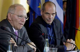 German Finance Minister Wolfgang Schaeuble, left, and Greece Finance Minister Yanis Varoufakis address the media during a joint press conference as part of a meeting in Berlin, Germany, Feb. 5, 2015.