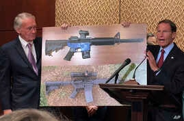 Sen. Edward Markey, D-Mass., (L), and Sen. Richard Blumenthal, D-Ct., display a photo of a plastic gun on July 31, 2018, on Capitol Hill in Washington.