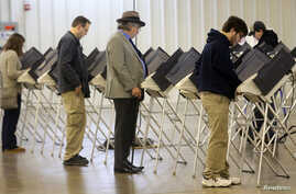 Voters cast their votes during the U.S. presidential election in Medina, Ohio, U.S. Nov. 8, 2016.