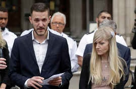 Chris Gard, the father of critically ill baby Charlie Gard finishes reading out a statement next to mother Connie Yates, right, at the end of their case at the High Court in London, Monday, July 24, 2017. The parents of critically ill baby Charlie Ga