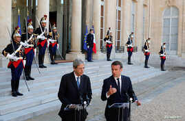 FILE - French President Emmanuel Macron meets Italian Prime Minister Paolo Gentiloni at the Elysee Palace in Paris, France, May 21, 2017.
