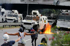 An armored riot police vehicle is seen on fire during a rally against Venezuela's President Nicolas Maduro in Caracas, Venezuela May 1, 2017.