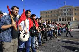 Protesters shout slogans in front of the Parliament in Athens on Nov. 6, 2012.