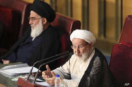 FILE - Chairman of the Iran's Assembly of Experts Ayatollah Mohammad Yazdi speaks during their biannual meeting in Tehran, Iran, Sept. 1, 2015. Yazdi, a leading conservative on the panel, was not re-elected last week.