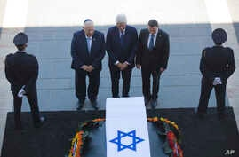 Former US President Bill Clinton, center, accompanied by Israel's President Reuven Rivlin, left, and Yuli Edelstein, the Speaker of the Knesset, pays respects by the coffin of former Israeli President Shimon Peres at the Knesset plaza in Jerusalem, S