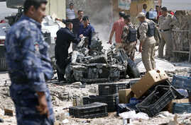 Security forces inspect the scene of a car bomb attack in Basra, 550 kilometers southeast of Baghdad, Iraq, Sunday, Sept. 9, 2012.