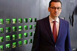 Polish Prime Minister Mateusz Morawiecki visits the Ulma Family Museum of Poles Who Saved Jews during WWII, in Markowa, Poland, Feb. 2, 2018.