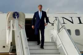 FILE - US Secretary of State John Kerry leaves his aircraft.