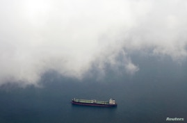 FILE - A tanker travels through the Singapore Strait.