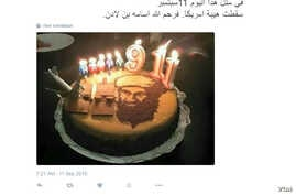 """A screenshot of a tweet by a user called """"Wife of prisoner 'Zawjat al-Aseer'"""" saying: """"On this day, Sept. 11, America's prestige was destroyed. God bless Osama bin Laden."""""""