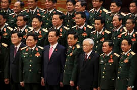 Vietnamese President Truong Tan Sang, front row left, Prime Minister Nguyen Tan Dung, front row third left, and Communist Party General Secretary Nguyen Phu Trong, front row third right, pose for a group photo with the Army generals after the electio...