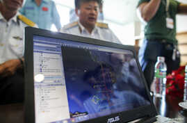 A map of a flight plan is seen on a computer screen during a meeting before a mission to find the Malaysia Airlines flight MH370 that disappeared from radar screens in the early hours of Saturday, at Phu Quoc Airport on Phu Quoc Island, March 10, 201