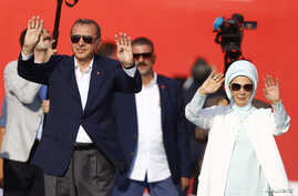 Turkish President Tayyip Erdogan and his wife  Emine Gulbaran attend Democracy and Martyrs Rally, organized by him and supported by ruling AK Party (AKP), oppositions Republican People's Party (CHP) and Nationalist Movement Party (MHP), to protest ag