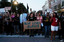 Demonstrators march in response to a not guilty verdict in the trial of former St. Louis police officer Jason Stockley, Sept. 16, 2017, in St. Louis.