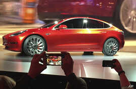 Tesla Motors unveils the new lower-priced Model 3 sedan at the Tesla Motors design studio in Hawthorne, California, March 31, 2016. Electric car maker Tesla said on Monday, July 3, 2017, that its Model 3 car will go on sale on Friday.