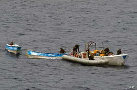 Photos taken from TCG Gelibolu as naval commandos seize pirate boats, 18 Apr 2010