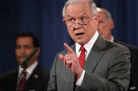 Attorney General Jeff Sessions, accompanied by, from left, National Counterintelligence and Security Center Director William Evanina, Director of National Intelligence Dan Coats, speaks during a news conference at the Justice Department in Washington...