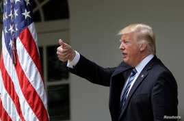 U.S. President Donald Trump gives a thumbs up during a National Day of Prayer event at the Rose Garden of the White House in Washington,  May 4, 2017.