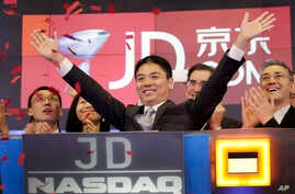 FILE - Liu Qiangdong, also known as Richard Liu, CEO of JD.com, celebrates the IPO for his company at the Nasdaq MarketSite, in New York, May 22, 2014. An attorney for Liu welcomes a decision by Minnesota prosecutors not to charge Liu after a Chinese