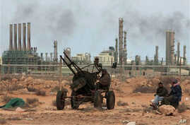 Rebels take their position in front the refinery oil complex, in Ras Lanouf town, eastern Libya, March 10, 2011