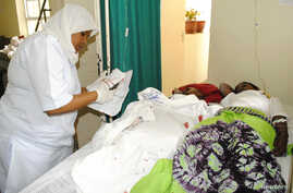 Catholic faithful receive treatment at the Mount Meru Regional Hospital after they were injured in an explosion at the new Catholic church in the northern Tanzanian town of Arusha, May 5, 2013.