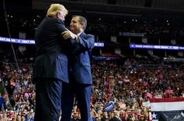 President Donald Trump is greeted by Sen. Ted Cruz, R-Texas, as he arrives for a campaign rally at Houston Toyota Center, Oct. 22, 2018, in Houston, Texas.