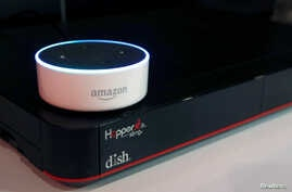 FILE - An Amazon Dot smart speaker is shown during the 2017 CES in Las Vegas, Nevada Jan, 6, 2017.