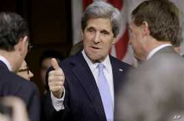 Senate Foreign Relations Chairman Senator John Kerry, President Barack Obama's nominee to become secretary of state, gives a 'thumbs-up' as he arrives before his confirmation hearing to testify before the committee to replace Hillary Rodham Clinton,
