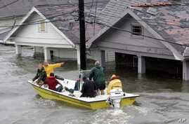 St. Berard Parish deputy sheriff Jerry Reyes uses his boat to rescue residents after Hurricane Katrina hit the area  causing flooding in their New Orleans neighborhood,  Monday Morning, Aug. 29,  2005.