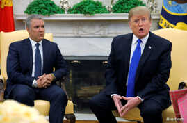 U.S. President Donald Trump talks with reporters as he sits with Colombian President Ivan Duque at the start of a meeting in the Oval Office of the White House in Washington, Feb. 13, 2019.