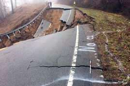 This image provided by the Tennessee Department of Transportation show damage to State Route 70 in Surgoinsville, Tenn., following a mudslide, Feb. 21, 2019.