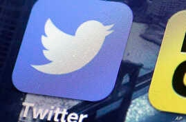 FILE - This Oct. 18, 2013, file photo, shows a Twitter app on an iPhone screen in New York. Twitter vowed to crack down further on hate speech and sexual harassment on its platform, days after CEO Jack Dorsey said in a tweet-storm on Oct. 18, 2017, t